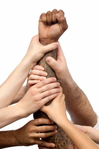 photo-24764091-business-people-with-hands-together-for-unity